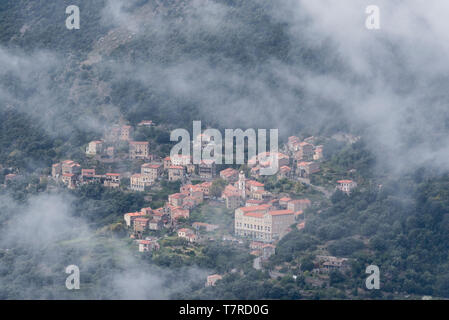 Town of Ota and Gorge de Spelunca from the nearby mountains - Stock Photo