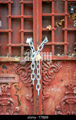 ornate, old metal doors chained and padlocked closed - Stock Photo
