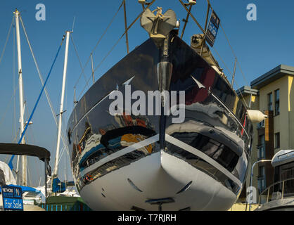 SWANSEA, WALES - JULY 2018: Racing yacht with a polished hull on sale in a boatyard in Swansea marina - Stock Photo