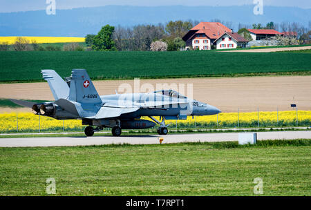 McDonnell Douglas F/A-18C Hornet of the Swiss Air Force before take-off in a picturesque landscape, Payerne, Switzerland - Stock Photo