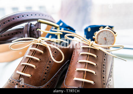 Men's leather brown shoes macro closeup still life isolated with socks, watch and shoelaces laces tied for wedding or interview preparation and belt o - Stock Photo