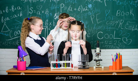 Happy children friendship. Teamwork. students doing science experiments with microscope in lab. Biology equipment. Little kids learning chemistry in school laboratory. Where little things mean a lot. - Stock Photo