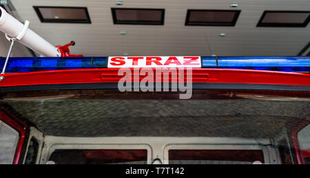 Blue warning signals placed on the roof in a fire truck with the Polish inscription 'STRAZ' translated into English 'Fire Brigade'. - Stock Photo