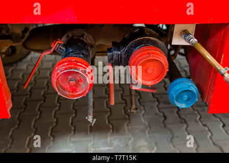 Water outlet valves placed on the side in a fire truck. - Stock Photo