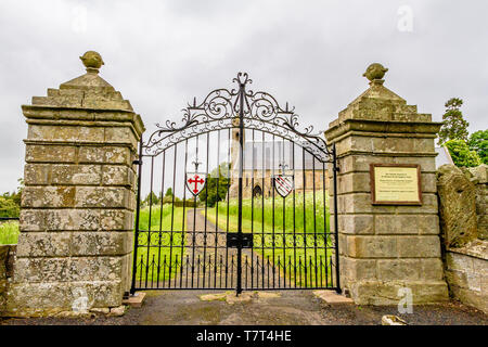 Entrance gate to Ford Church, Ford and Etal, Northumberland, UK. May 2018. - Stock Photo