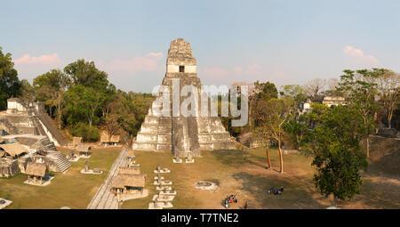 Mayan ruins; Tikal Guatemala panorama late afternoon with Maya Temple 1 ( Jaguar Temple ), UNESCO world Heritage site, Tikal Guatemala Central America - Stock Photo