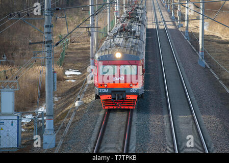ULYANOVKA, RUSSIA - APRIL 10, 2018: Top view of the approaching suburban electric train ET2M-067 - Stock Photo