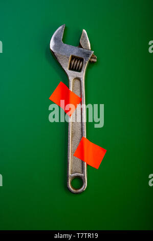 wrench is attached to the background with red markers. Business concept. - Stock Photo