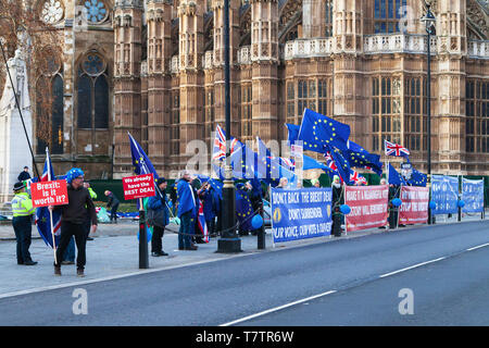 London, United Kingdom - December 19, 2018: Demonstrators against Brexit hold placards and European Union flags in front of the Houses of Parliament o - Stock Photo