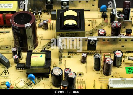 Macro photography of capacitors and other electronic components in an electronic board - Stock Photo