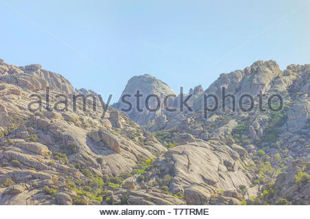 Regional park La Pedriza, in Manzanares el Real (Madrid - Spain). Multiple granitic rock formations. At the background the summit known as El Yelmo. S - Stock Photo