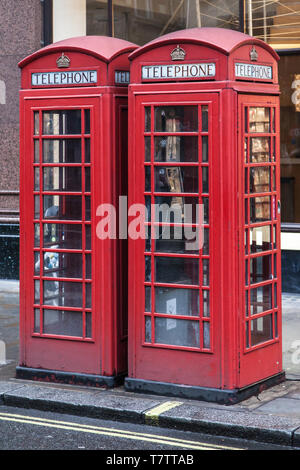 Two Red Telephone Boxes in The Strand, London, United Kingdom. - Stock Photo