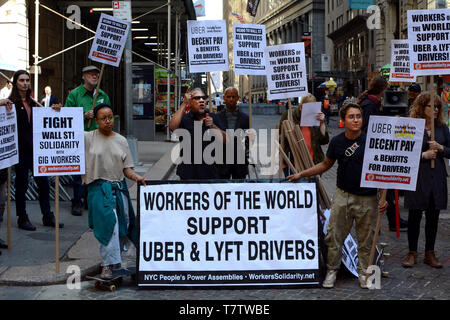 Uber and Lyft Drivers With Signs on Strike and Protesting Outside the New York Stock Exchange at 26 Wall Street In New York, NY, USA on May 8th, 2019 - Stock Photo
