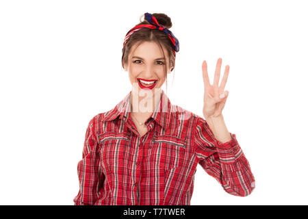 Young girl counting three with fingers. Closeup cutout portrait of a beautiful woman girl wearing red checkered buttoned shirt isolated on a pure whit - Stock Photo