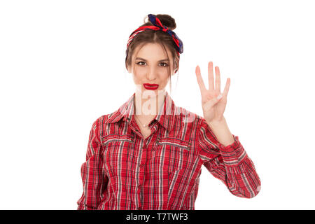 Young girl counting four isolated over pure white background. Closeup cutout portrait of a beautiful woman girl wearing red checkered buttoned shirt.  - Stock Photo