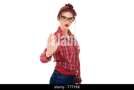 Closeup portrait young angry serious woman showing her denial No Stop talk to hand gesture with palm outward isolated pure white background Negative h - Stock Photo