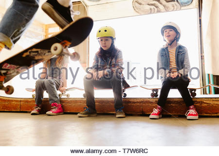 Kids watching at indoor skate park - Stock Photo