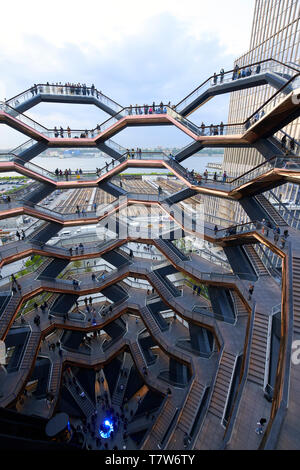 People visiting the interactive artwork called vessel at Hudson Yards in New York City - Stock Photo