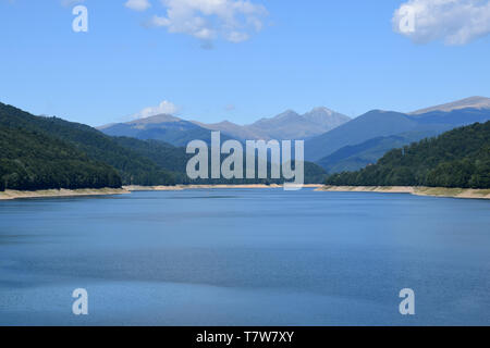 Landscape of Lake Vidraru (Lacul Vidraru). View from Vidraru dam in Fagaras Mountains. Transfagarasan road, Romania. - Stock Photo