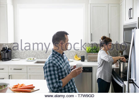 Couple cooking in kitchen - Stock Photo