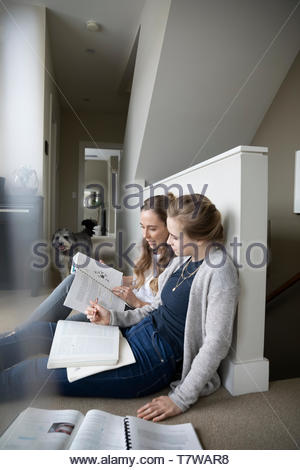 Mother helping teenage daughter with homework - Stock Photo