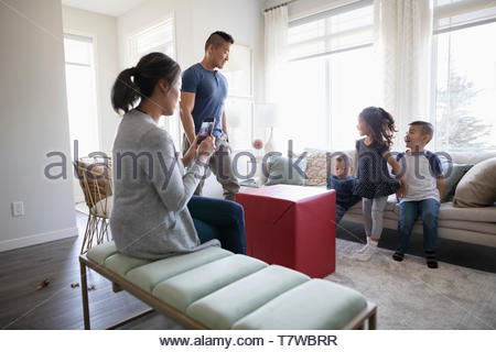 Excited children waiting to open large gift - Stock Photo