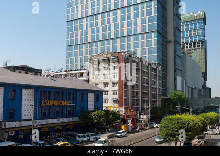 04.02.2017, Yangon, Myanmar, Asia - A modern office building and a luxury hotel are flanking the Junction City shopping mall in the downtown core. - Stock Photo