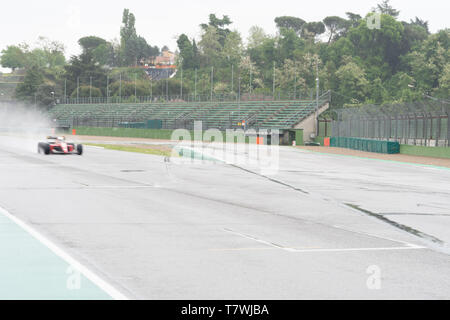 Vintage Ferrari is flying on the wet track - Stock Photo