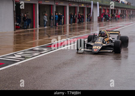 at the historic Minardi Day the famous Wolf Racing WR7 is approaching the wet track - Stock Photo