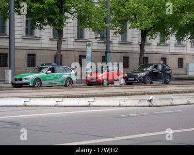 Augsburg, Germany - May 7, 2019: German police control in the city of Augsburg in new blue police uniform - Stock Photo