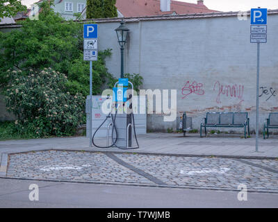 Augsburg, Germany - May 7, 2019: Electronic charging station in the city with parking lot - Stock Photo