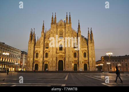 Milan/Italy - March 16, 2017: Beautiful winter panoramic view to the  Duomo square and the famous cathedral in early morning hours. - Stock Photo