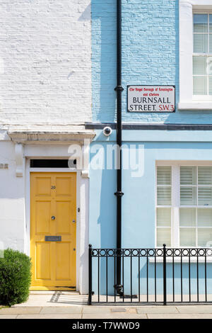 Colourful painted houses in Burnsall street, Chelsea, London, England - Stock Photo