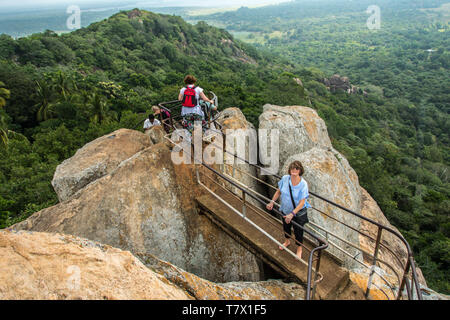 Climb to the top of sacred Aradhana Gala (Rock of Meditation) at Mihintale, Sri Lanka. - Stock Photo