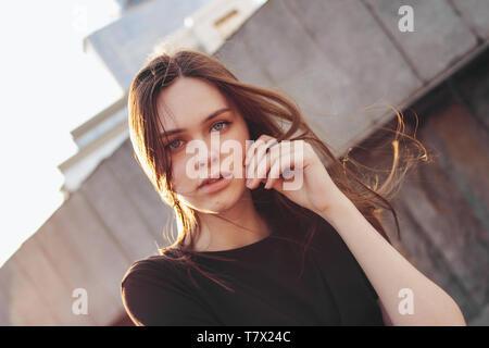 Young beautiful long wind hair girl fashion model on city street - Stock Photo