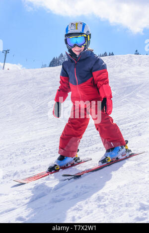 Cute little boy skiing on slope - Stock Photo