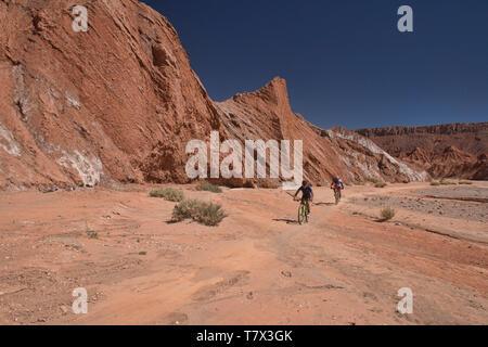 Mountain biking through amazing desert landscape in the Valle Marte, San Pedro de Atacama, Chile - Stock Photo