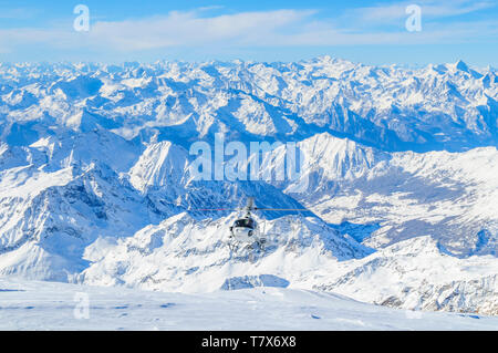 Freeriders arriving on top of Monte Rosa glaciers with a helicopter - Stock Photo