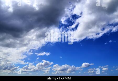 Beautiful white fluffy clouds on a deep blue sky in high resolution - Stock Photo