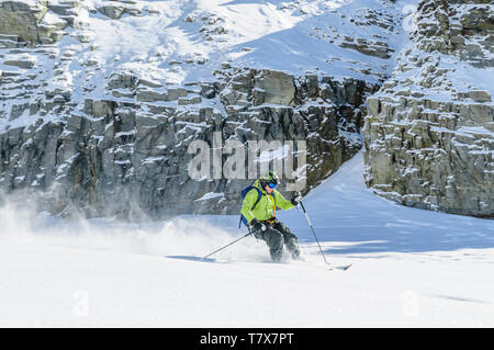 Expert on alpine skis skiing on the glaciers of Monte Rosa near Gressoney - Stock Photo