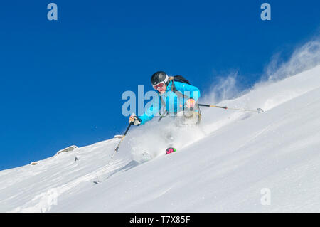 Sporty young woman skiing on the glaciers of Monte Rosa - Stock Photo