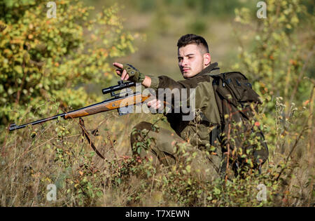 Hunter hold rifle. Hunting permit. Bearded serious hunter spend leisure hunting. Hunting equipment for professionals. Hunting is brutal masculine hobby. Man wear camouflage clothes nature background. - Stock Photo