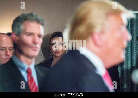 Ivanka Trump listens in the background as her father, the republican Presidential candidate Donald J. Trump hosts a press conference in Milford, NH, where he announced the endorsement from former Massachussetts Senator Scott Brown (left). - Stock Photo