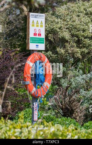 Lifebuoy, AKA Ring buoy, Lifering, Lifesaver, Life donut, Life preserver, Lifebelt, Kisby ring, Perry buoy. Life saving ring by water in the UK.