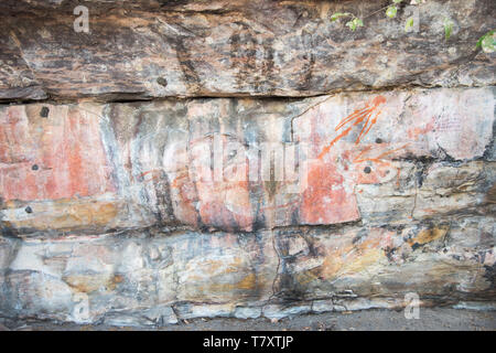 Ancient rock art on the natural stone shelters in Kakadu National Park in the Northern Territory of Australia - Stock Photo