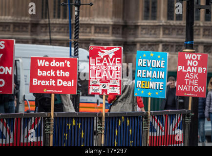 Anti-Brexit placards fastened to railings outside Westminster, London, UK. - Stock Photo