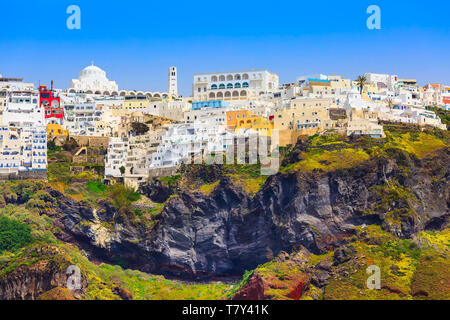 Fira or Thira panoramic view in Santorini Island with white and blue houses on high volcanic rocks in Greece - Stock Photo