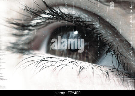 Female eye with pupil and eyelashes close-up with overlay of technological futuristic elements of artificial intelligence. - Stock Photo