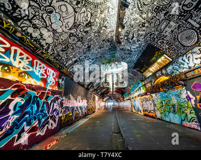 The Banksy Tunnel, ( Leake St Tunnel or Leake Street Arches ) legal Graffiti venue under Waterloo train station, London, UK. - Stock Photo