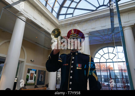 A life-size replica of U.S. Army Bugler Staff Sgt. Jesse Tubb in Welcome Center of Arlington National Cemetery.Arlington.Virginia.USA - Stock Photo
